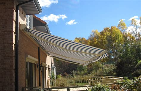 bright awning on mediterranean style house rolltec
