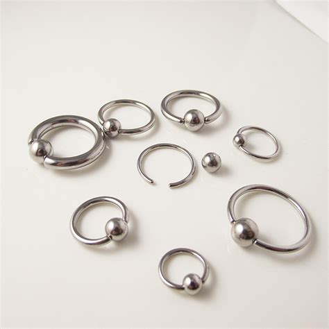 how do you open a captive bead ring 1piece big size gold black titanium captive bead hoop ring