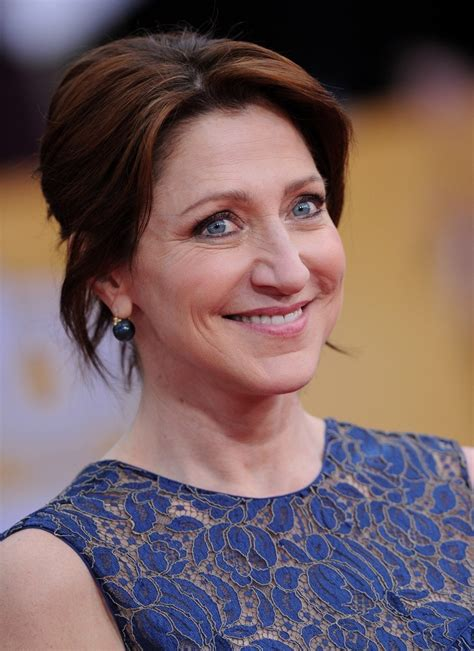 easy buns and updo for women over 50 edie falco s easy updo haute hairstyles for women over