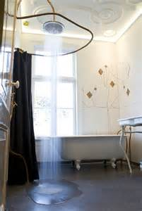 vintage and sculptural bathroom design with cooper pipes