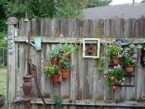 backyard decor old and rustic backyard garden fence decoration with vertical hanging planter pots ideas