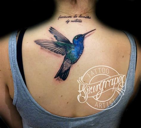 black and grey hummingbird tattoo black and grey flying hummingbird tattoo on girl upper back
