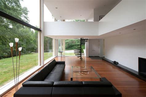 house design with mezzanine in living area restored 1969 modern glass house modern living room new york by fivecat studio