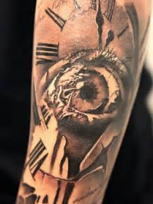 original designed big clock tattoo with scary eye on arm
