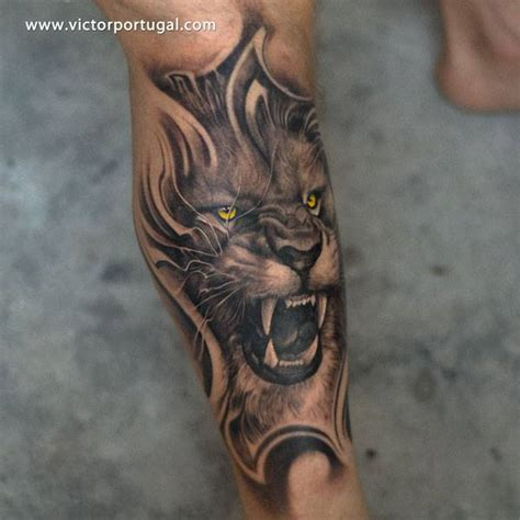 biomechanical lion tattoo arm realistic lion tattoo by victor portugal