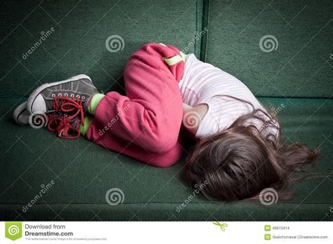 Curled Up On The by Curled Up In Fetal Position Stock Photo