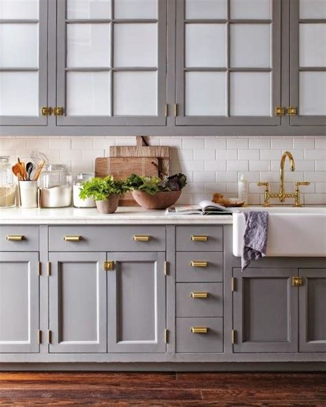 kitchen cabinets grey color grey with brass in the kitchen greige design