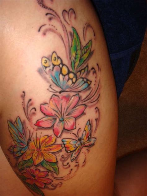 butterfly thigh tattoos colored flowers and butterfly thigh
