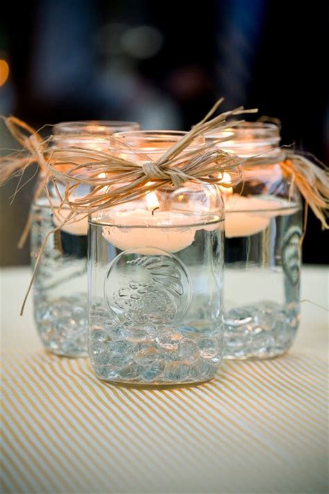 wedding centerpieces with jars and candles jar centerpieces floating candles emmaline