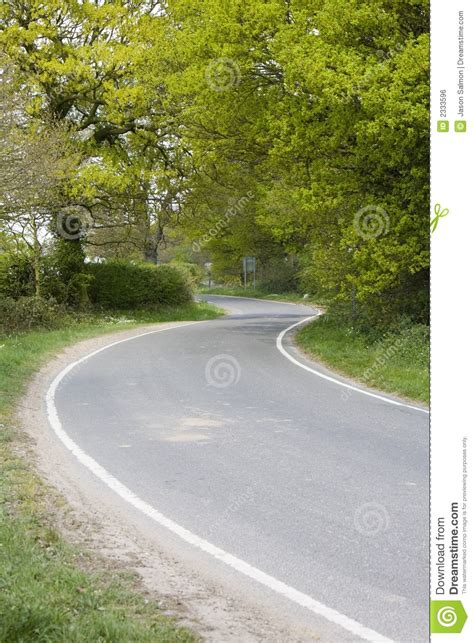 curved road with trees on both sides stock photo colourbox country road royalty free stock image image 2333596