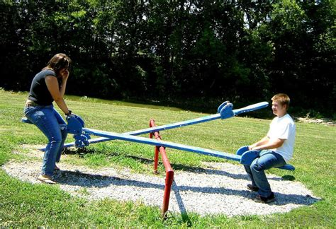 types of swings for kids what is a seesaw with pictures