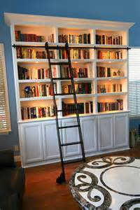 bookcase with a rolling library ladder entertainment