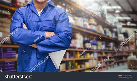 section supervisor mid section supervisor standing arms crossed stock photo