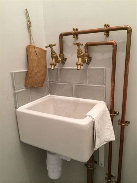 bathroom belfast sink copper piping and baby belfast sink in cloakroom maybe a