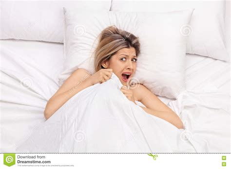 how to make a girl scream in bed scared young woman lying in bed stock image image 70842071