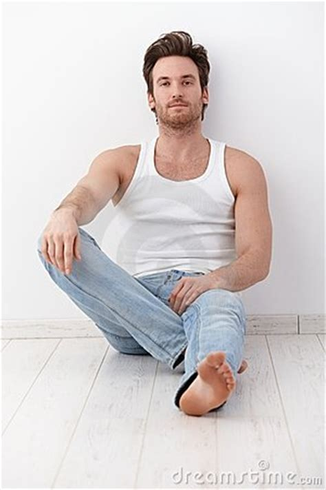 handsome sitting on floor by wall royalty free stock