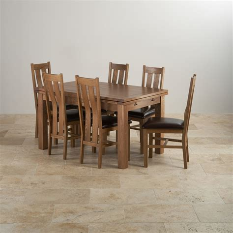 Solid Oak Extending Dining Table And 6 Chairs Rustic Oak Extending Dining Table 6 Arched Back Leather Chairs