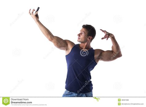 The Best Pose Takes Time by Handsome Muscular Taking Selfie With Cell Phone