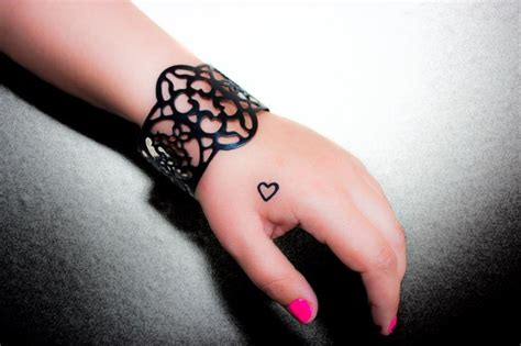 heart tattoo on hand tattoos
