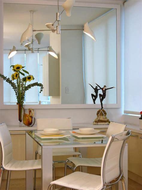 small modern white dining room  large mirror hgtv