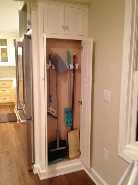 storage cabinets for mops and brooms broom closet laundry room roselawnlutheran