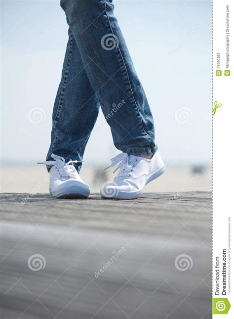 comfortable shoes to stand in female legs in comfortable white shoes standing outdoors