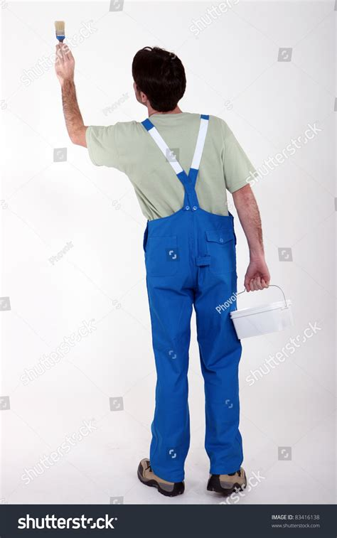 paint man man painting wall stock photo 83416138 shutterstock