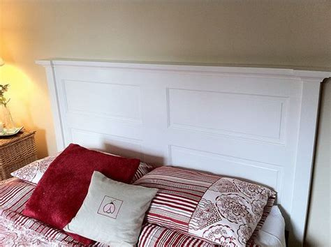 white headboard made out of an door for the home