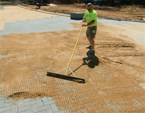 mechanical installation for sand set pavers aqua paving