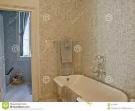 Old fashioned tub mosaic tile bathroom idea