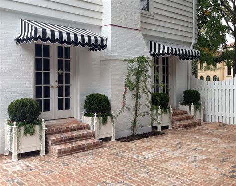 black and white striped awning seeing stripes chic awnings la dolce vita