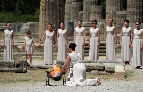 Lighting Olympic Torch by The 2012 Olympic Torch Is Lit In Greece To Start Its