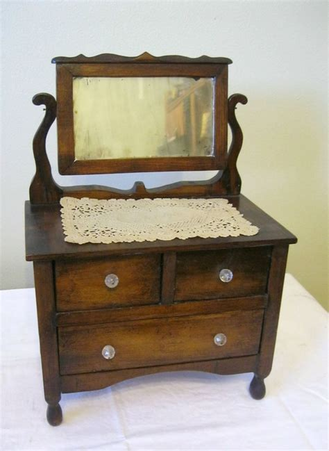 vintage small wooden doll dresser with original mirror
