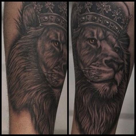 black ink crown on lion head tattoo on left arm black ink crown on lion head tattoo design for forearm