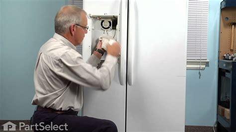 refrigerator repair replacing  recess door spring ge