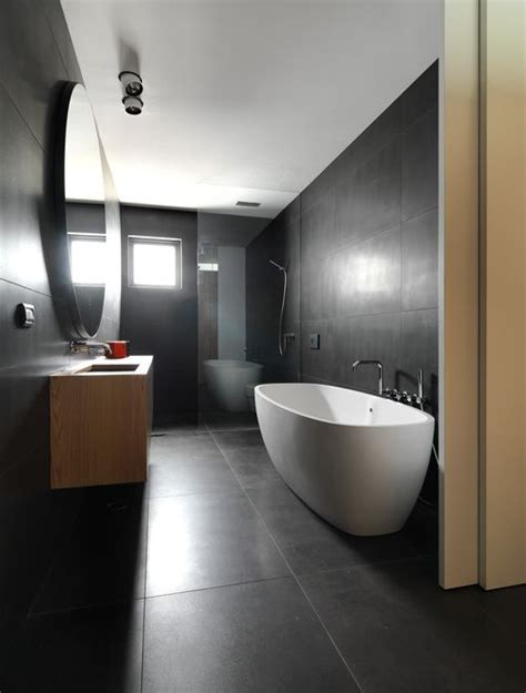 Bathroom Tile Pattern Ideas create open seamless spaces with large format tiles see