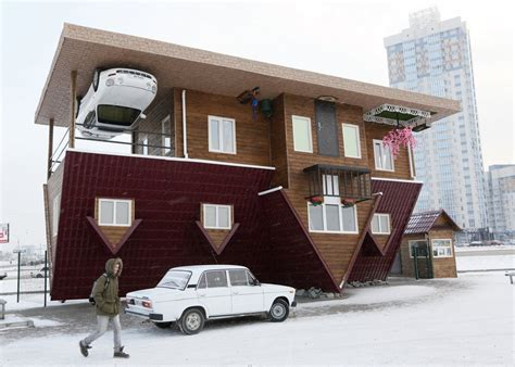upside down house 16 weirdest houses business insider