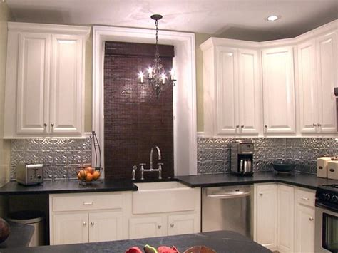 white tin backsplash silver backsplash black countertops white cabinets home black counters