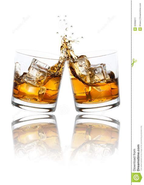 clinking glasses toasting whiskey glasses stock image image of dining
