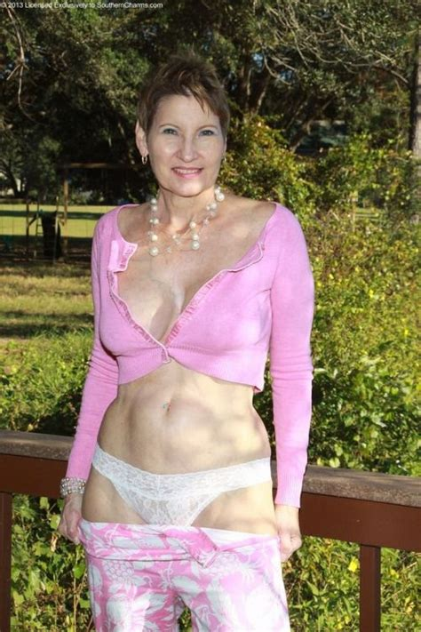 tops for 65 year old ladies mature woman wearing pink top showing her white thong