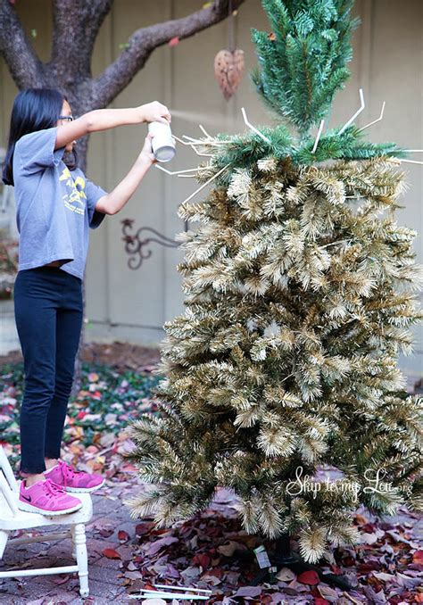 spray painted christmas trees the most beautiful tree with this diy gold tree tutorial skip to my lou