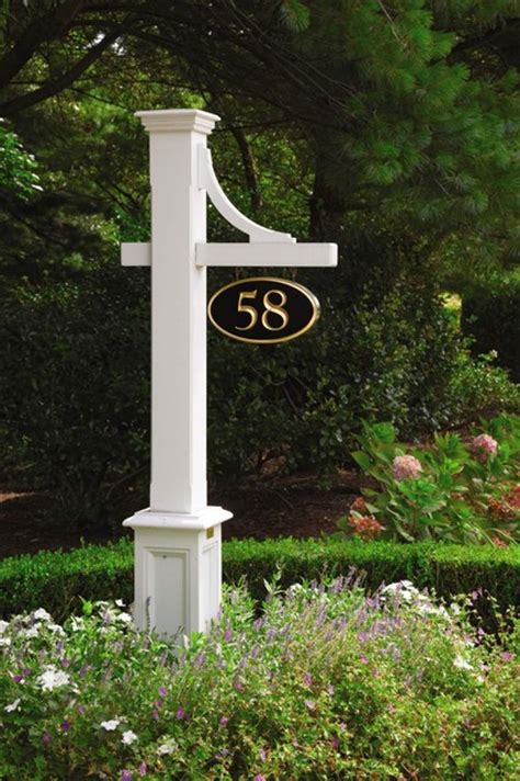 house number sign for l post fence and outside structures near the coast traditional