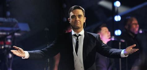 Someone Doesnt Like Robbie Williams by Robbie Williams Admits He S Given Away 17 Of His Brit