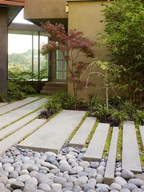 gartengestaltung mit gräsern gartengestaltung ideen sch 246 ner gartenweg mit steinen und