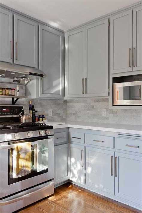 Gray Countertops With White Cabinets by Gray Shaker Kitchen Cabinets With Engineered White Quartz Countertops Transitional Kitchen