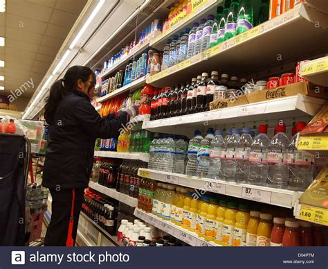 Shelf Stacking by Staff Stacking Shelves In Tesco Stock Photo Royalty Free