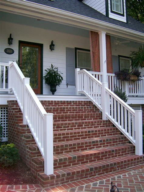 Front House Stairs Design Brick Steps Provide Contrast To The Bright White Home Exterior The Porch Features A Wood