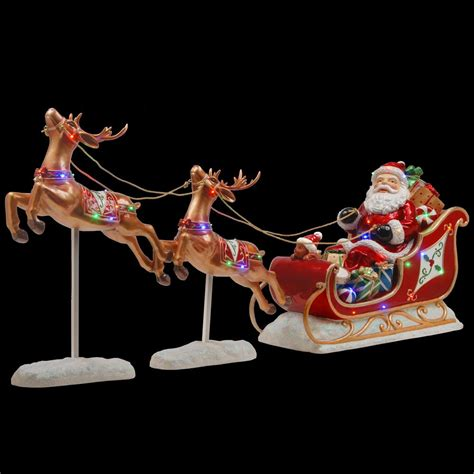 where to buy a sled and reindeer for the roof of your house national tree company santa s sleigh and reindeer assortment bg 19387ast the home depot