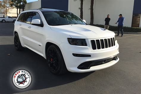 white jeep grand cherokee custom jeep srt wrapped in 3m satin white wrap wrap bullys