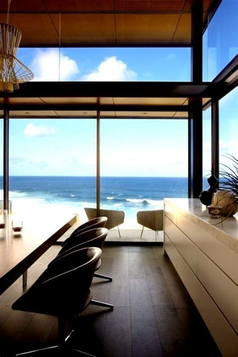 view interior of homes modern beach house with glass front and a wonderful sea